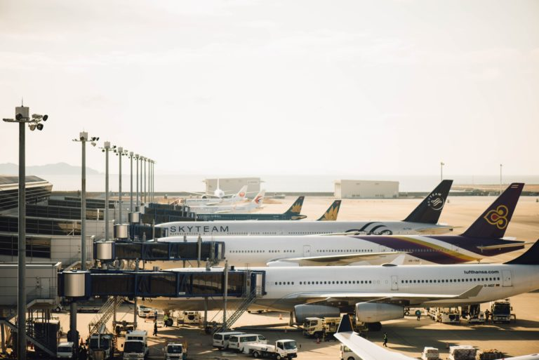Row of aircraft at airport gates.